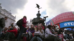LONDON - OCTOBER 7: Crowd sits on the steps of the Eros statue on October 7, - stock footage