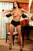 Stock Photo of Sensual portrait of lingerie woman in vintage fur and stockings