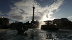Trafalgar Square fountain and Nelson's monument with amazing light effect Stock Footage