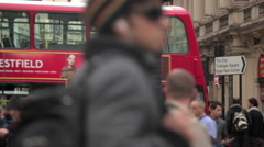 People and traffic at Piccadilly Circus in London Stock Footage