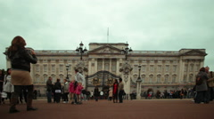 LONDON - OCTOBER 8: Unidentified family takes pictures in front of Buckingham Stock Footage