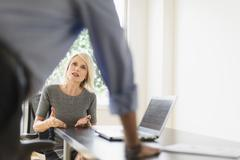 Older Caucasian business people arguing in office meeting Stock Photos