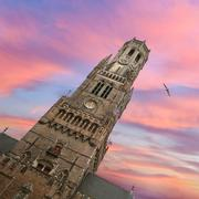 Belfry bell tower on sunset in Bruges - stock photo
