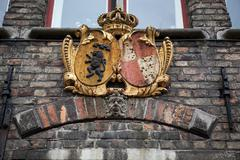 Decoration on old houses of Bruges, Belgium Stock Photos