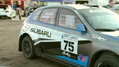 Subaru Rally Car Leaves Pits Stock Footage