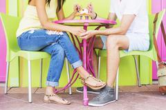 Hispanic couple sharing ice cream sundae Stock Photos