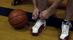 Young man tying basketball shoes. Stock Footage