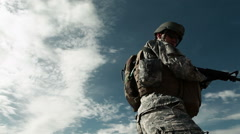 Soldier gives Hang 10 sign while on firing line during training. - stock footage