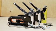 Metal stapler for repair work in the house. - stock footage