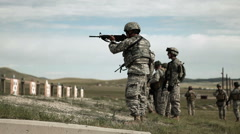 Green Beret soldiers practicing firing weapons at range Stock Footage