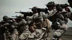 Soldiers practice aiming and firing - stock footage