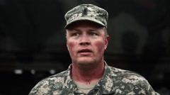 Lieutenant in camouflage breathing hard Stock Footage