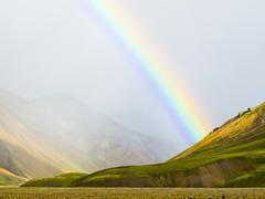Rainbow over rural fields and hillside, Landmannalaugar, Fjallabak Nature Stock Photos