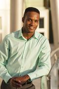 Black businessman leaning on railing Stock Photos