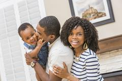 Black family playing in living room Stock Photos