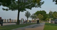 4k, Pedestrians walk near Sheepshead Bay, Brooklyn, NY Stock Footage