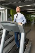 Businessman Exercising On A Treadmill Stock Photos
