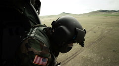 Soldier looking out of landing helicopter - stock footage
