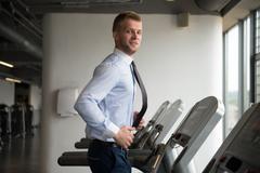 Businessman Running On Treadmill - stock photo