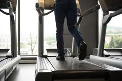 Businessman Running On Treadmill In Gym Stock Photos