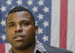 Close up of Black man in front of American flag Stock Photos