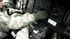 Black Hawk copilot looking at and adjusting instruments. - stock footage