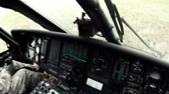 Black Hawk copilot landing and checking door. - stock footage
