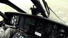 Black Hawk copilot landing and checking door. Stock Footage