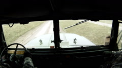 Troop transport in convoy training, being passed by Humvee. Stock Footage