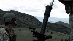 Clip of two soldiers firing mortar. Arkistovideo