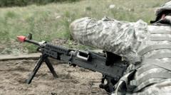 Clip of soldier loading chain machine gun at training range. Stock Footage