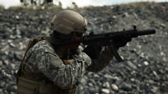 Handheld shot of soldier shooting automatic small target rifle at range. Stock Footage