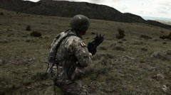 Soldier firing 40 mm grenade launcher attached to M4 assault rifle while Stock Footage