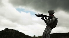 Low shot of soldier firing 40 mm grenade launcher, while standing. Stock Footage