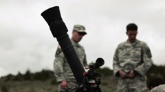 Mortar launcher in foreground and in focus. Stock Footage