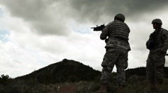 Soldier firing 40 mm grenade launcher attached to M4 assault rifle. Stock Footage