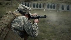 Soldier shoots a Sterling Submachine Gun - stock footage