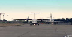 Airport Passenger Jets taxiing on runway Stock Footage
