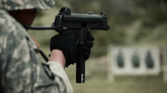 Soldier shooting a Walther MP in target practice. - stock footage