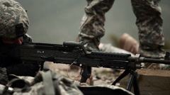 Soldier finishes rounds on an M240 Stock Footage