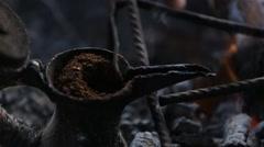 Bedouins Making Coffee in a Finjan on a Bonfire Stock Footage