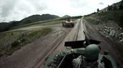 Two soldiers taking out an ammunition belt for a machine gun on a humvee Stock Footage