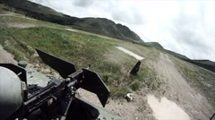 Soldier on humvee trains with gun Stock Footage