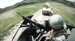 Soldier checks machine gun on humvee Stock Footage