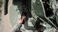 Gunner adjusts position in humvee Stock Footage