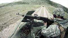 Humvee gunner in military convoy Stock Footage