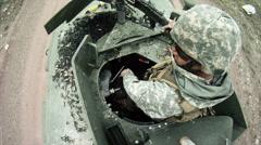 Gunner prepares his machine gun on a humvee Stock Footage