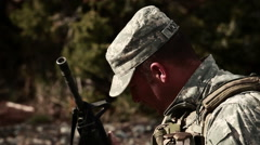 A soldier loading and firing an automatic assault rifle. - stock footage