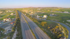 Modern transport infrastructure. Top view of road, fields, rural area. Aerial Arkistovideo