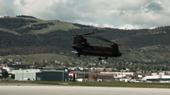 Panning shot following a CH-47 Chinook Helicopter. Stock Footage
